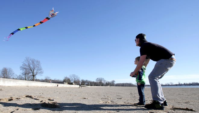 Taking advantage of the 64 degree weather, Eric Little, 33 of West Bloomfield and his son Orlando Little, 4 decided to head to Pontiac Lake Recreation Area in Waterford on Saturday, February 18, 2017 to fly their kite for the first time this year.