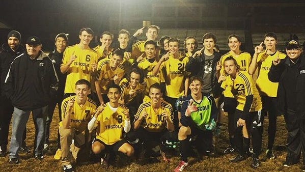 Ben Nickol (10) and the Tuscola soccer team.