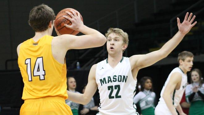 Mason's Matt King (22) guards Riley Voss of Moeller.