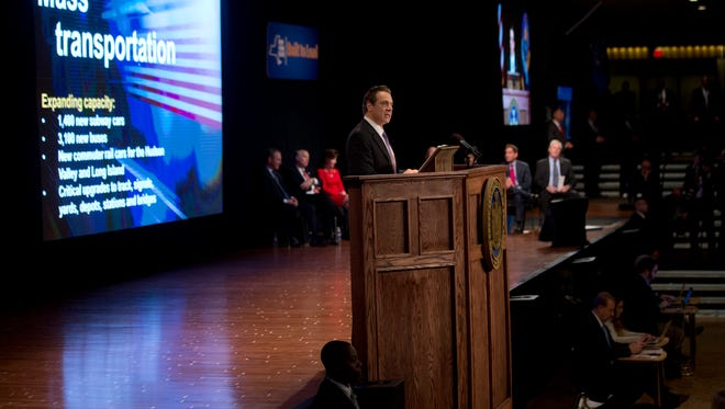 New York Gov. Andrew Cuomo delivers his State of the State address and executive budget proposal at the Empire State Plaza Convention Center on Wednesday, Jan. 13, 2016, in Albany, N.Y. (AP Photo/Mike Groll)