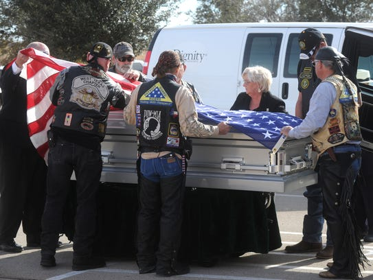 Members of the Patriot Guard Riders serve as pallbearers