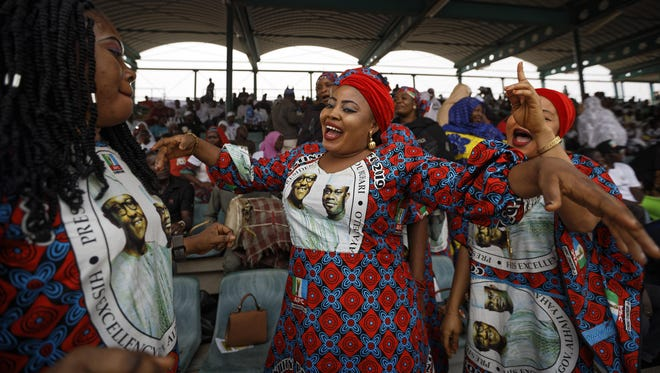 Supporters of incumbent President Muhammadu Buhari sing and dance in advance of his arrival at a campaign rally in Abuja, Nigeria.