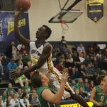Images from Friday's District 6A-11contest between Lehigh and Fort Myers. The Green Wave won  63-60.