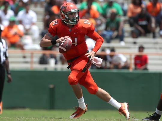 FAMU's Ryan Stanley scrambles out of the pocket against
