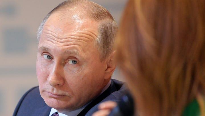 Russian President Putin: Former KGB with economics degree
