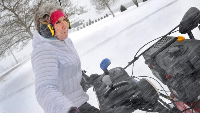 Cathy Cushott faces windy snow conditions as she uses a snowplow on her Hopewell Township property in March of this year.