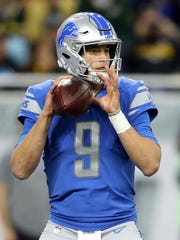 Lions quarterback Matthew Stafford looks to pass against the Packers in the first half at Ford Field on Dec. 31, 2017.