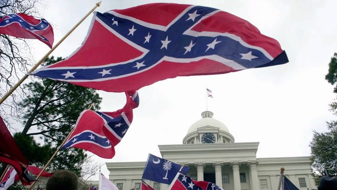 Several thousand Confederate flag-waving supporters rally March 20, 2000, at the state Capitol in Montgomery, Ala. The Tuscaloosa-based League of the South organized the rally to persuade state officials to again fly the Confederate battle flag atop the Capitol's dome.