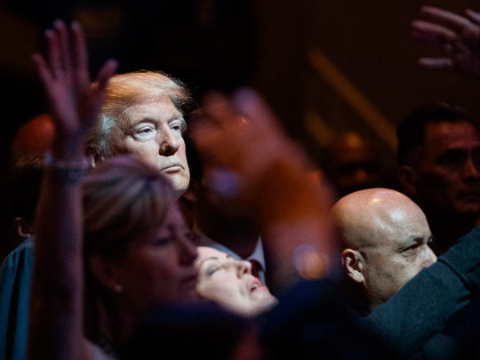 Republican presidential candidate Donald Trump stands during a service at the International Church of Las Vegas, Sunday, Oct. 30, 2016, in Las Vegas.