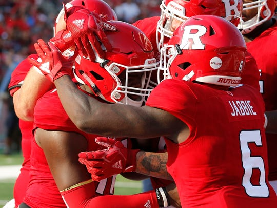 Rutgers Scarlet Knights quarterback Johnathan Lewis (11) celebrates with teammates after scoring a touchdown against the Morgan State Bears during the first half at High Point Solutions Stadium.