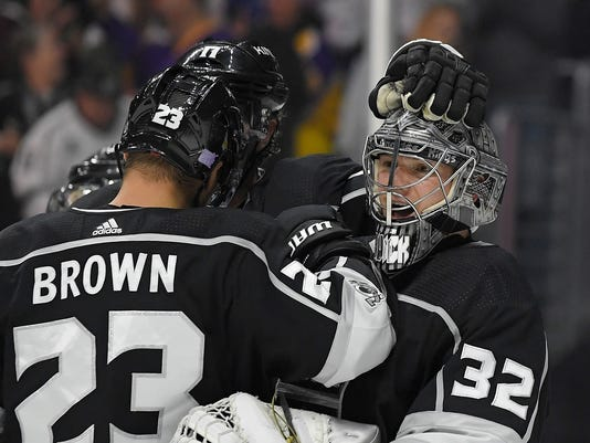 Los Angeles Kings goalie Jonathan Quick, right, celebrates with right wing Dustin Brown after the Kings defeated the Toronto Maple Leafs 5-3 in an NHL hockey game, Thursday, Nov. 2, 2017, in Los Angeles. (AP Photo/Mark J. Terrill)