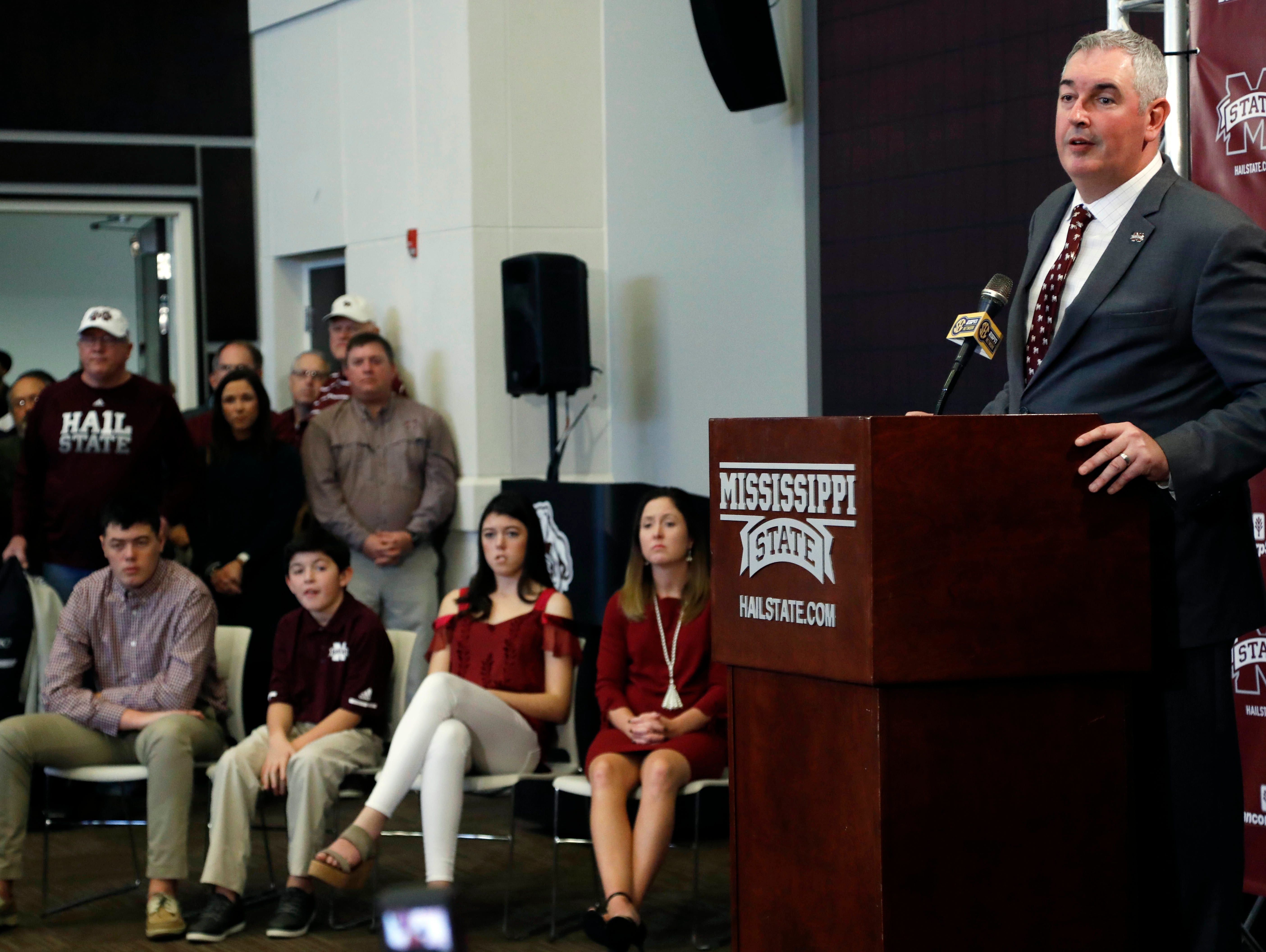 """New Mississippi State football coach Joe Moorhead says the """"foundation is laid"""" for football success at the school and he looks forward to trying to lead the Bulldogs to the top of the Southeastern Conference at his official introduction by the university to football team supporters and reporters, Thursday, Nov. 30, 2017, in Starkville, Miss. Family members attending the news conference, were from left, his children, Mason, 15, Donovan, 10, Kyra, 17, and his wife Jennifer. (AP Photo/Rogelio V. Solis)"""