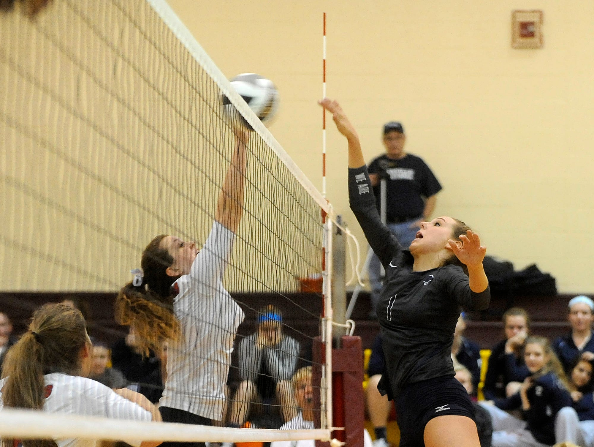 Granville's Brooklyn Holthaus tips the ball to Lakewood's Jenna Neumeyer during a Division II district semifinal on Thursday, Oct. 29, 2015, at Licking Heights. The Blue Aces defeated the Lancers 3-1 and will advance to play Bishop Hartley in the district finals at 1 p.m. on Saturday at Licking Heights.