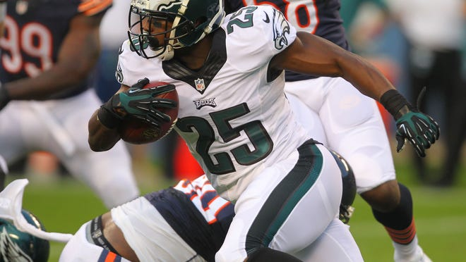 Philadelphia Eagles running back LeSean McCoy runs with the ball during the first quarter of a preseason game Friday against the Chicago Bears at Soldier Field.