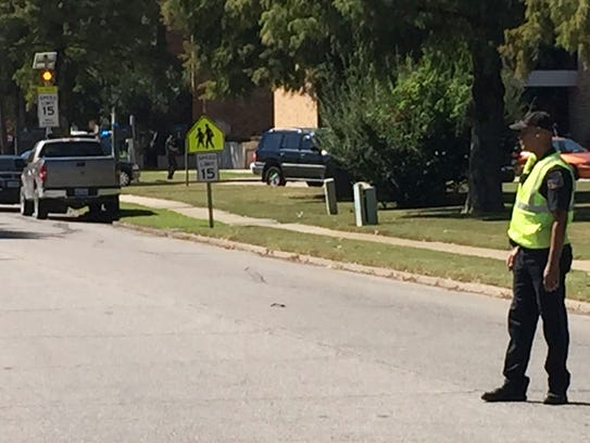 A law enforcement officer stands watch as emergency