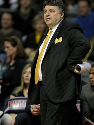 Oakland basketball coach Greg Kampe works against Michigan State on Dec. 14, 2013, at the Palace of Auburn Hills.