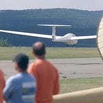 Spectators can watch a procession of high-performance sailplanes, like this one seen in 2005, take off and land during the national soaring contest set to begin July 26 at Harris Hill in Big Flats.