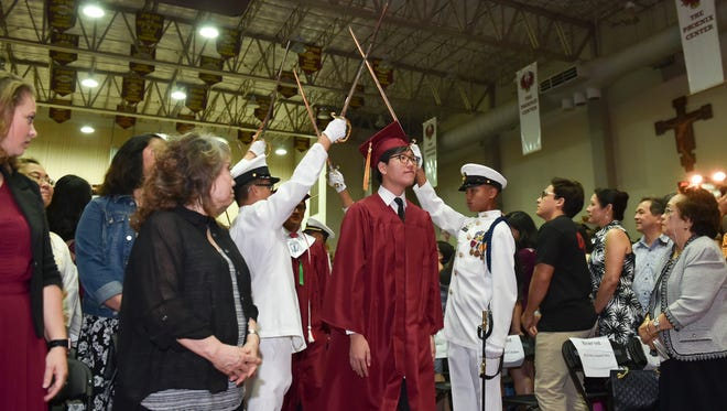 Father Duenas Memorial School Class of 2017 graduating students march in for their commencement exercise at the FDMS Phoenix Center on May 10, 2017.
