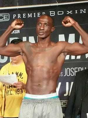 Joseph Elegele weighs in before his January bout with Alex De Jesus. Elegele won that match with a sixth round KO.