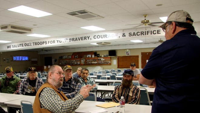 Joe Martinez, right, listens to concerns of Carlsbad veterans on Thursday afternoon.