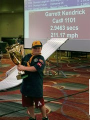 Garrett Kendrick holds the Pro Stock Division Champions Cup at the fourth annual World Championship Pinewood Derby on June 30, 2018.