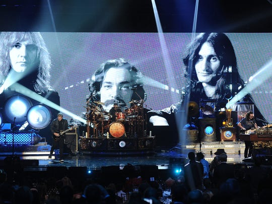 Alex Lifeson, Neil Peart, and Geddy Lee of Rush perform on stage at the 28th Annual Rock and Roll Hall of Fame Induction Ceremony at Nokia Theatre L.A. Live on April 18, 2013 in Los Angeles, California.