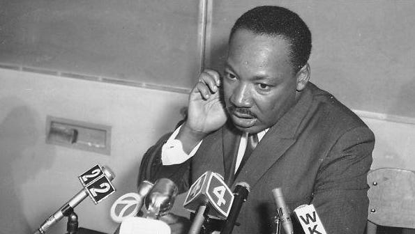 The Rev. Martin Luther King Jr. speaks at a press conference after his speech at Grosse Pointe South High School on March 14, 1968.
