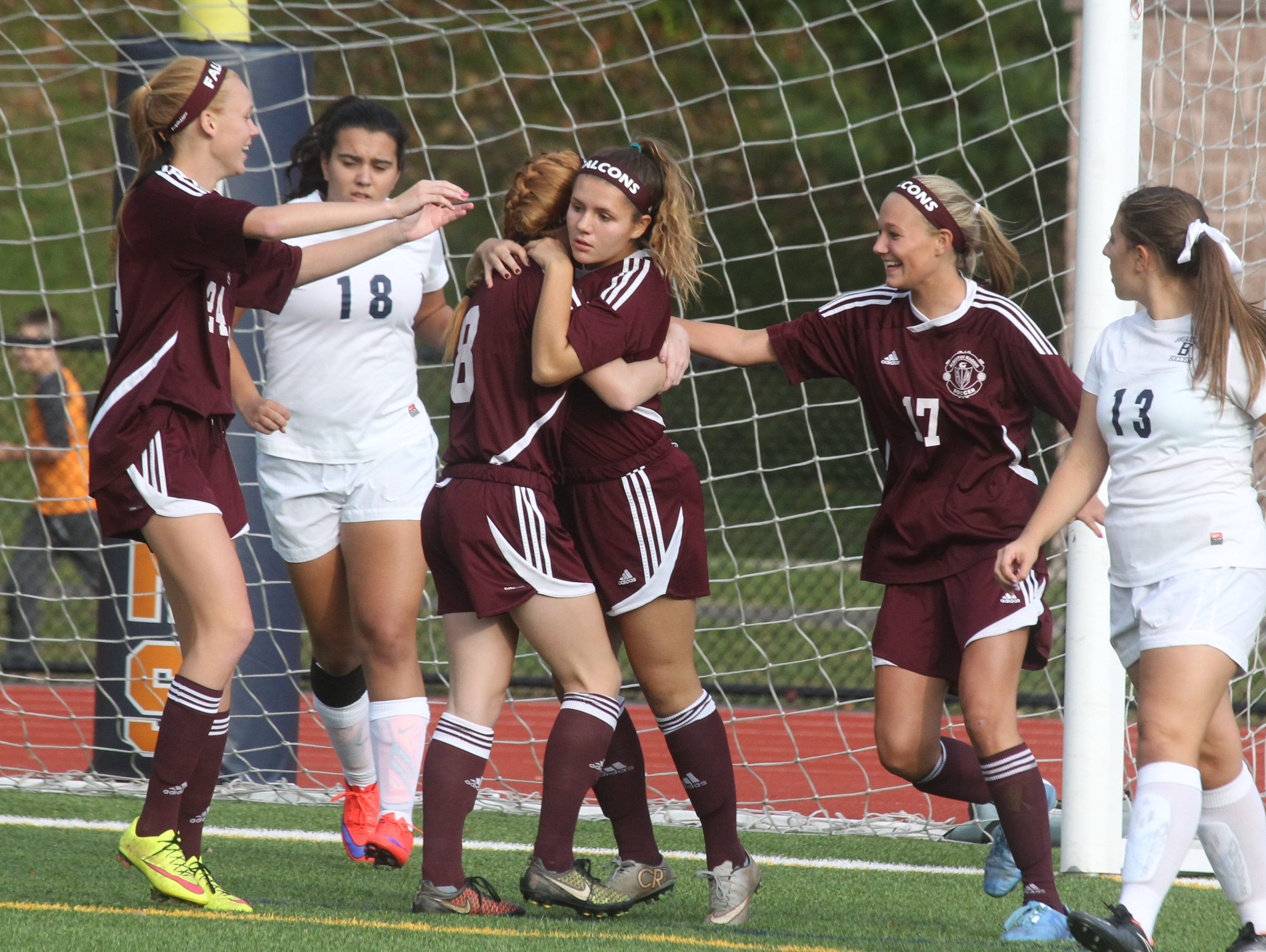 Albertus Magnus players celebrate a goal by Victoria McNamara, center, during a game at Briarcliff Oct. 8, 2015.