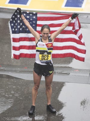 Desiree Linden of the U.S. celebrates after crossing the finish line as the winner of the 2018 and 122nd Boston Marathon.