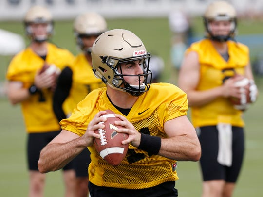 Quarterback David Blough rolls out to pass during Purdue