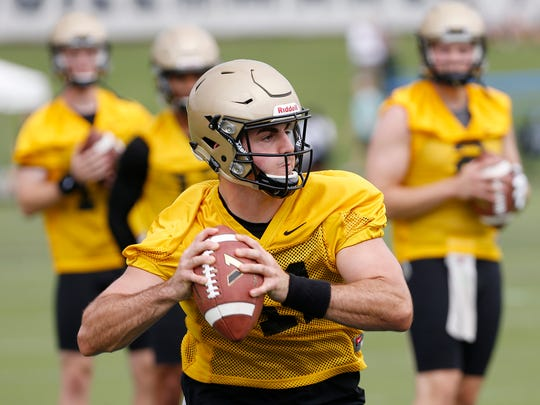 Quarterback David Blough rolls out to pass during Purdue football practice Thursday, August 3, 2017, in West Lafayette.