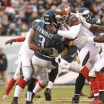 Nov 22, 2015; Philadelphia, PA, USA; Tampa Bay Buccaneers defensive end William Gholston (92) and defensive tackle Henry Melton (90) hit Philadelphia Eagles quarterback Mark Sanchez (3) during the fourth quarter at Lincoln Financial Field. The Buccaneers defeated the Eagles, 45-17. Mandatory Credit: Eric Hartline-USA TODAY Sports