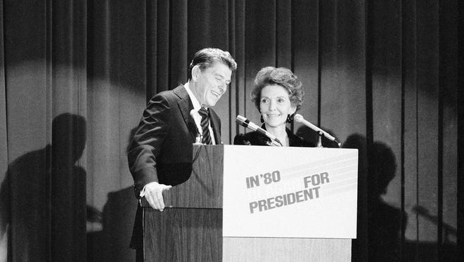 Former California Gov. Ronald Reagan and his wife, Nancy, face audience at $500-a-plate GOP fund raising dinner in New York City Tuesday, Nov. 13, 1979.  Reagan had just formally announced that he was seeking the GOP nomination for the presidency.