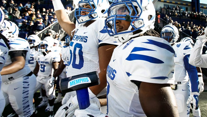 University of Memphis running back Darrell Henderson carries the team's sledgehammer onto the field before taking on Navy at Navy-Marine Corps Memorial Stadium in Annapolis, Maryland.