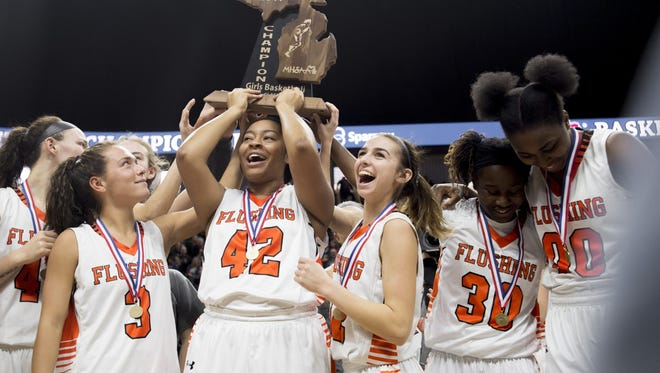 Flushing won the state Class A girls basketball championship at the Breslin Center. The girls champions will be crowned at Calvin College for the next two seasons.