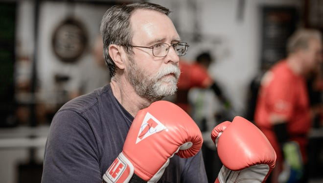 Dan Washburn, who suffers form Parkinson's disease, takes Rock Steady Boxing classes at Sweat Therapy fitness to help fight symptoms of the disease.