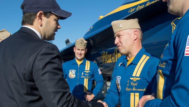 Sen. Marco Rubio shakes hands with Capt. Ryan Bernacchi during the annual Blue Angels Homecoming Airshow in Pensacola on Nov. 10, 2017.