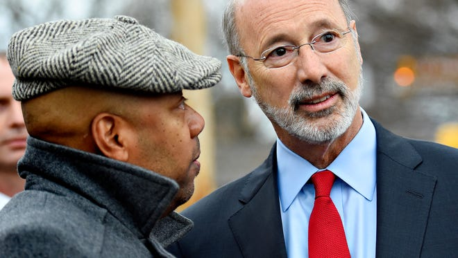 President of York County Libraries Robert Lambert, left, speaks with Gov. Tom Wolf prior to a press conference at the York County History Center in York City, Friday, Dec. 22, 2017. Dawn J. Sagert photo