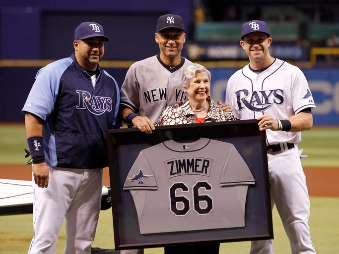 Sept. 16: Derek Jeter is honored before the Rays game with a Don Zimmer Jersey by Zoot Zimmer, catcher Jose Molina and third baseman Evan Longoria.