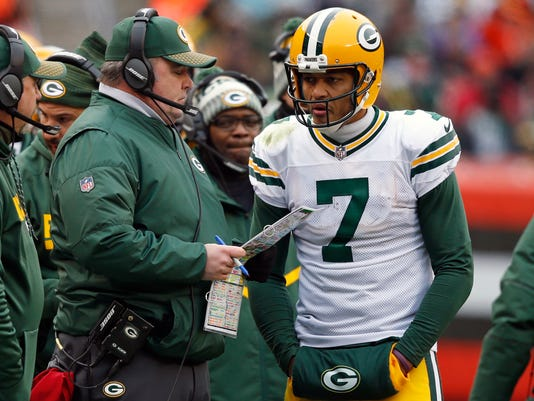 FILE - In this Sunday, Dec. 10, 2017, file photo, Green Bay Packers head coach Mike McCarthy, left, talks with quarterback Brett Hundley in the second half of an NFL football game against the Cleveland Browns in Cleveland. The Green Bay Packers are going back to backup Brett Hundley at quarterback with Aaron Rodgers done for the season. Hundley went 3-4 as a starter while Rodgers recovered from a collarbone injury.(AP Photo/Ron Schwane, File)