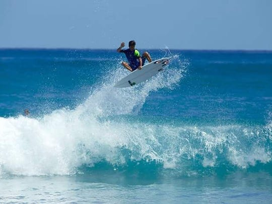 """""""One of the hardest things recently to deal with is not being able to surf,"""" Jonathon Gosman says. Gosman enjoys water sports in this file photo."""