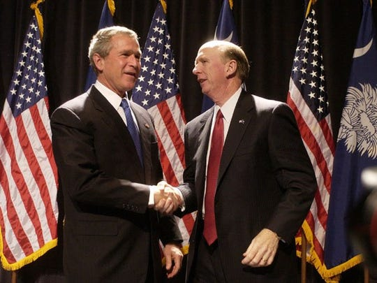 S.C. Speaker of the House David Wilkins, right, shakes hands with President George Bush after Bush's speech at the Palmetto Expo Center in Nov. 2003.