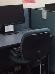 This photo provided by Eaton County shows a bank of computers in the clerk's office that include Kaspersky antivirus software.