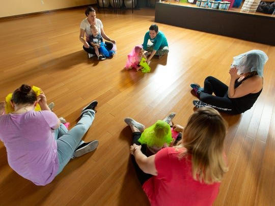 Mothers participate with their young children in a Zumbini class, instructed by Amy Richards, in Las Cruces.