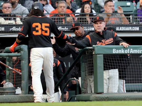 San Francisco Giants manager Bruce Bochy (15) congratulates shortstop Brandon Crawford (35) after scoring in the second inning of a baseball game against the Colorado Rockies, in San Francisco, Saturday, Sept. 15, 2018. (AP Photo/Scot Tucker)