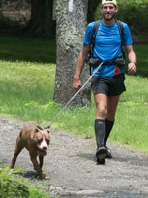 Lance Ness and his dog, Ruthie, walk the trail. Ness, 31, Windsor Township in York County, took the Half Gallon Ice Cream Challenge Friday, June 1, 2018 at Pine Grove Furnace General Store. He finished the ice cream in one hour one minute.  Ness gave up a six-figure sales job in Houston to return home and find a new path in life. He's hiking the entire Appalachian Trail from Springer Mountain in Georgia to Mount Khatadin in Maine.