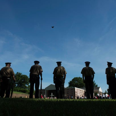 A butterfly glides above the heads of the Retired Veterans