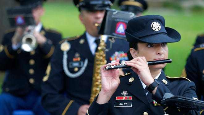 In a Thursday, June 29, 2017 photo, Sgt. Leanne Raley performs with the 323rd Army Band during a retirement ceremony at Fort Sam Houston. The Army is breaking up the 323rd Army Band, called 'Fort Sam's Own,' ending a run that has seen musicians from the post serenading everything from command change ceremonies and funerals for heroic soldiers to downtown parades. The 323rd performed at the mayor's inaugural this week and will play its final Fiesta next year. It is being phased out along with three others around the country under an Army restructuring plan. (Kin Man Hui/San Antonio Express-News)/The San Antonio Express-News via AP)/The San Antonio Express-News via AP)