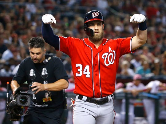 Nationals Bryce Harper (34) gestures at home celebrating