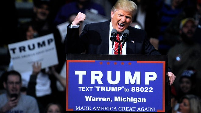Republican presidential candidate Donald Trump fires up the crowd during a rally Friday at the Macomb Community College Sports & Expo Center in Warren.